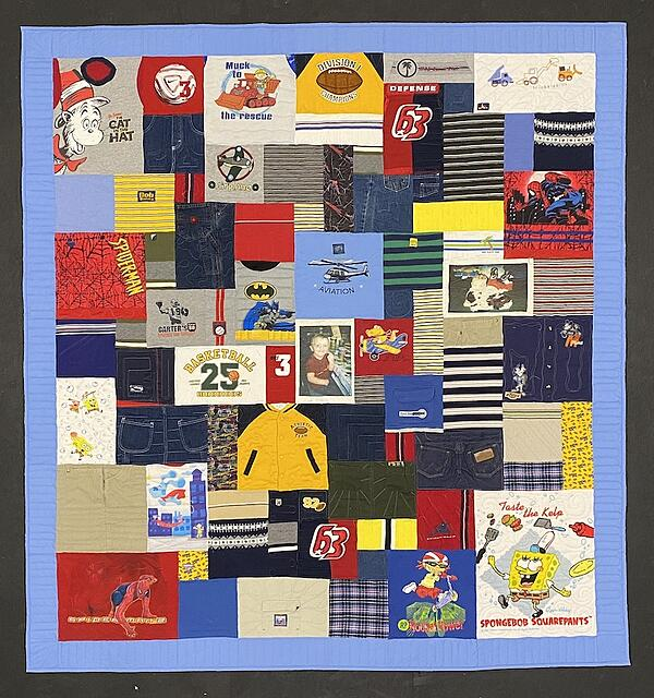 Memorial quilt made from a small boy's clothing.