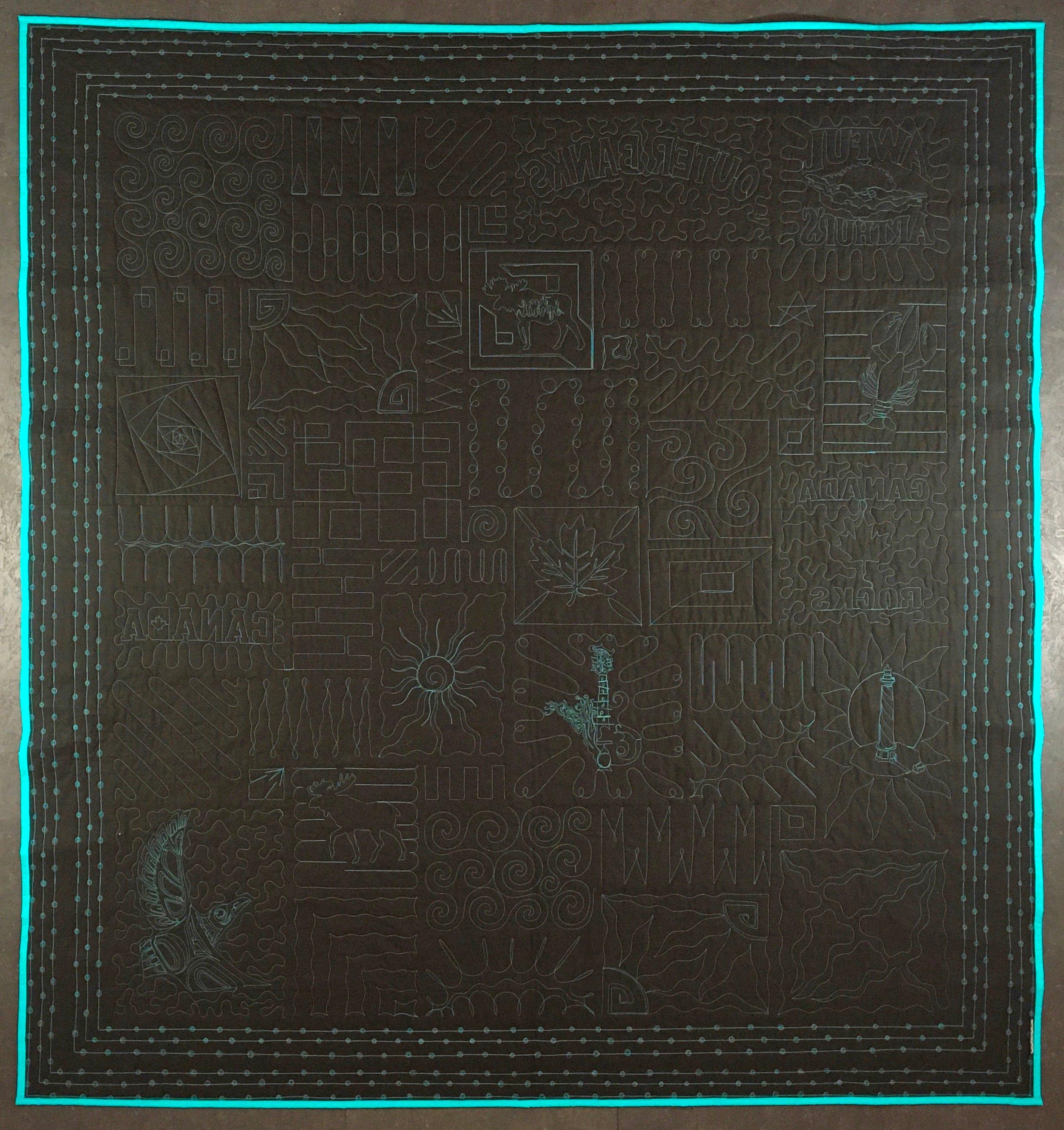 Back of black travel quilt