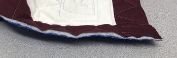 The raw edge of a T-shirt quilt