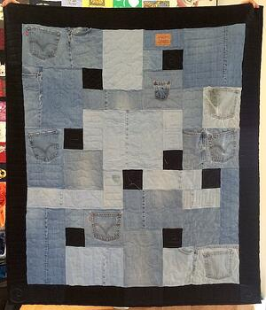 Blue jeans transformed into a quilt.