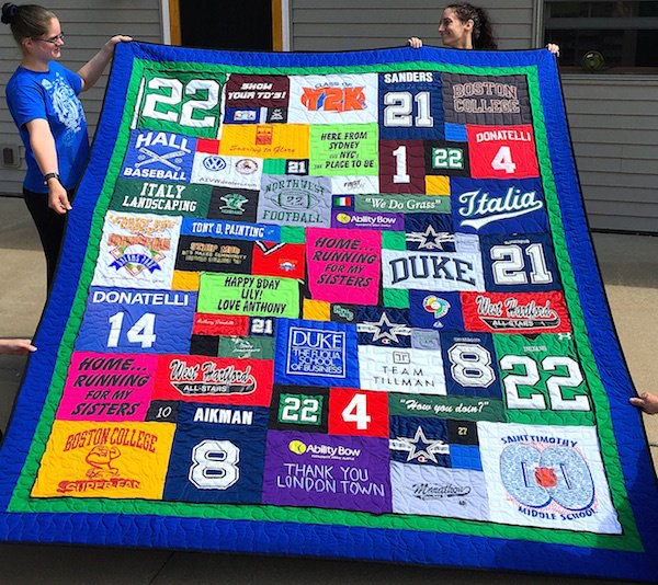 This T-shirt quilt has a double border and pipping between the border and the T-shirt part of the quilt.