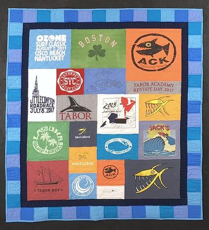 "T-shirt quilt with a 4"" pieced + 2"" solid border"