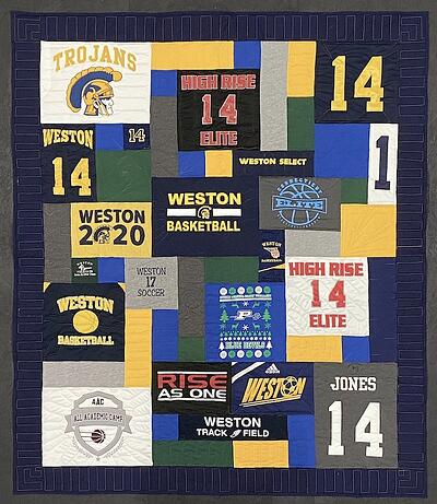 Use a border and blank blocks to make a T-shirt quilt large.