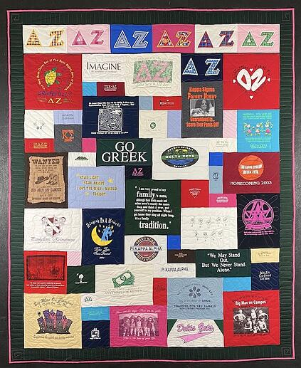"T-shirt quilt with a 2"" solid border"