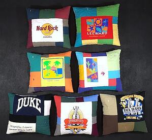 The fronts of a group of 7 T-shirt pillows.