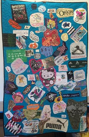 a messed up crazy style T-shirt quilt. This is not how to make a T-shirt quilt!