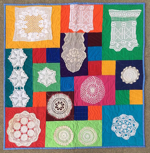 quilt made with doilies