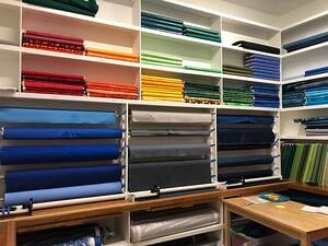A professional T-shirt quilt maker' fabric room