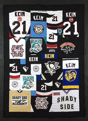 This is a photo of a quilt made from hockey jerseys.