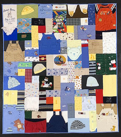 Baby clothes quilt with lots of hats