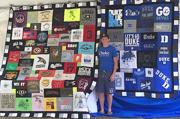 "A young man with his high school graduation and his ""I am going to Duke"" T-shirt quilt"