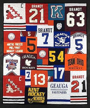 A photo of a hockey jersey quilt that also includes some T-shirts