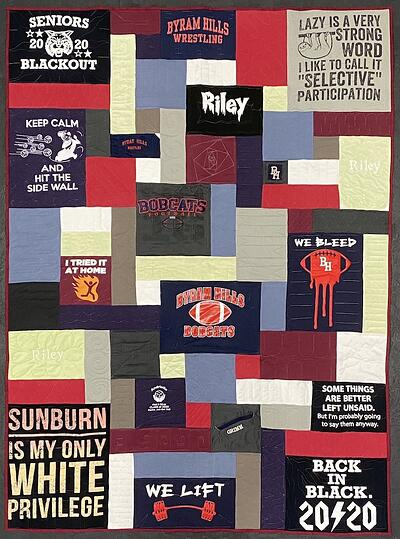 Use blank blocks to make a T-shirt quilt large.