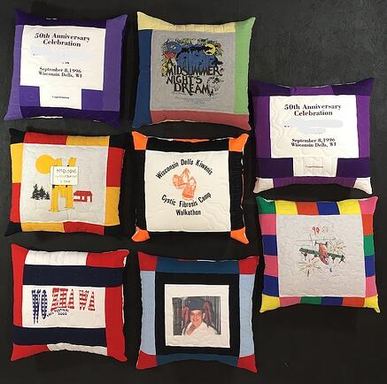 A group of 8 memorial pillows made from T-shirts.