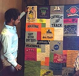 Matthew looking at his T-shirt quilt
