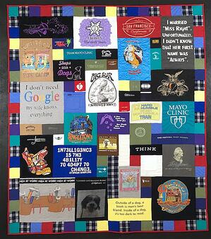 Memorial quilt with plaid and solid color border.