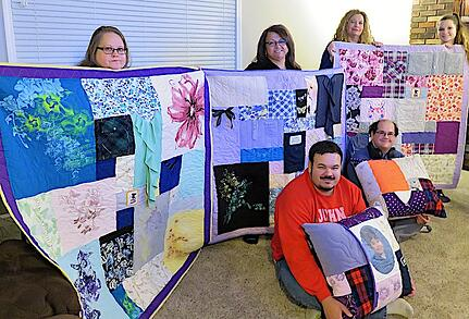 Memorial quilts  and pillows made for the children of a woman who died.