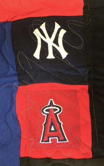 two baseball caps mixed in with T-shirt in a T-shirt quilt