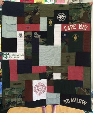 Military uniforms made into a quilt to celebrate a military career.