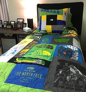 Northface T-shirt quilt on dorm bed