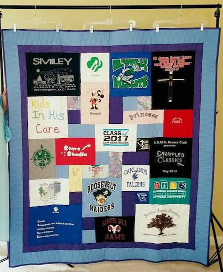 A T-shirt quilt hung with commercial pant hangers