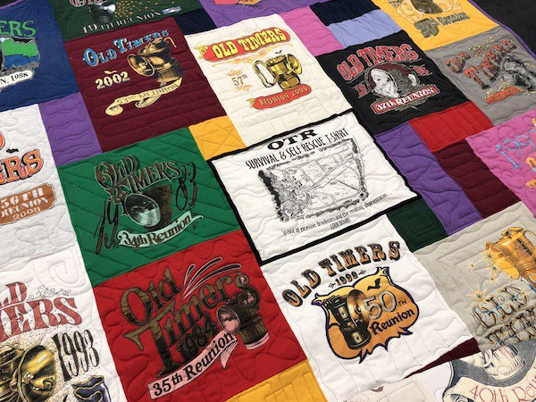 Piping on centered block in a T-shirt quilt