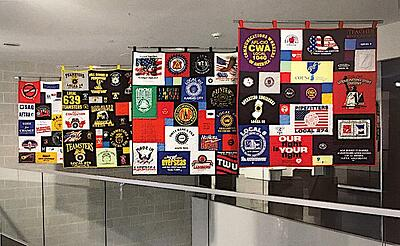 Quilting Hanging in Museum with hanging loops
