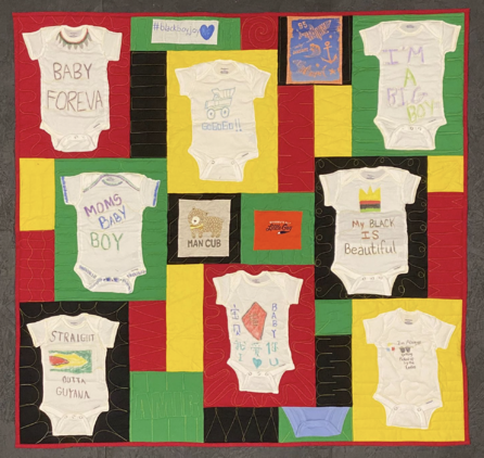 Baby Onesies turned into a quilt. Onesies were created at a baby shower and then transformed into  quilt when the lucky baby turned 1.