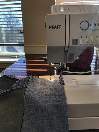 Sewing machine working on jean quilt