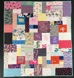 Simple baby clothes quilt by Too Cool T-shirt Quilts
