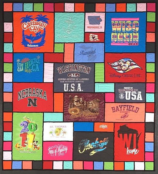 "Stained glass T-shirt quilt with 4"" pieced border"