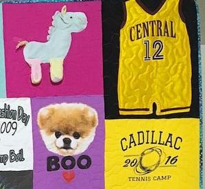 Close up of a graduation T-shirt quilt.