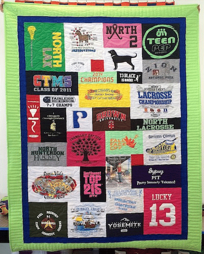 Graduation T-shirt quilt with a blue and lime green border.