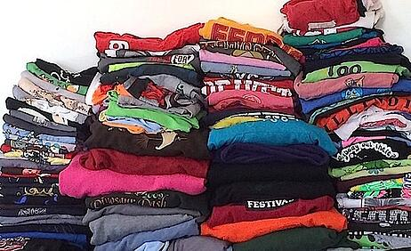 A huge pile of T-shirts ready for a quilt