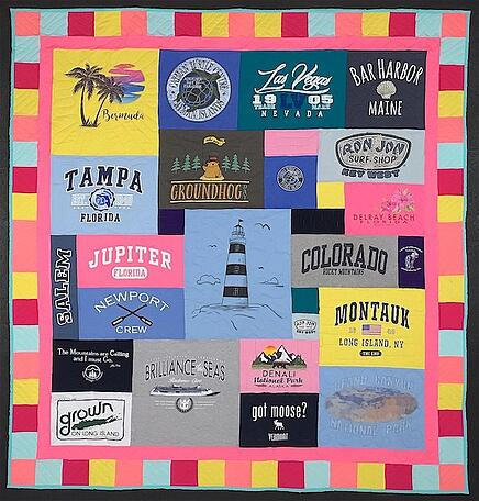 Travel T-shirt quilt  with a cheerful pieced and solid border.