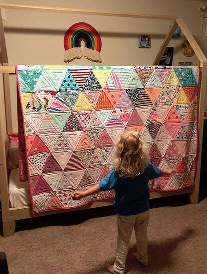Triangle quilt with girl