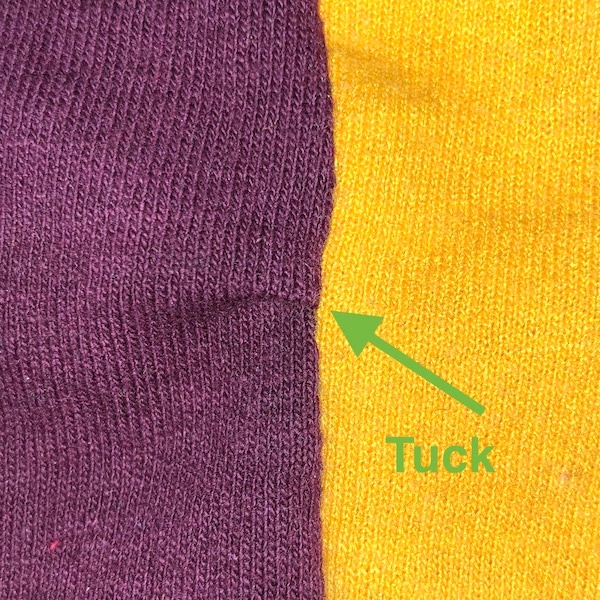 This photograph show a tuck in a seam of a T-shirt quilt looks like.