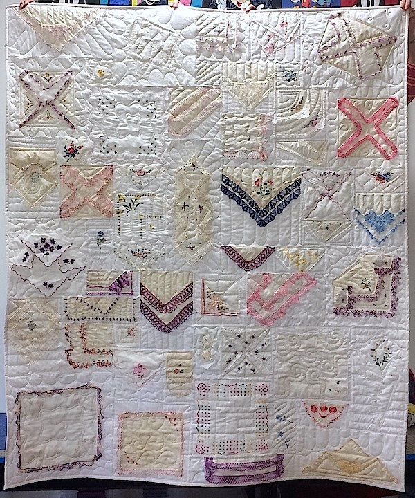 Hankie quilt on white background