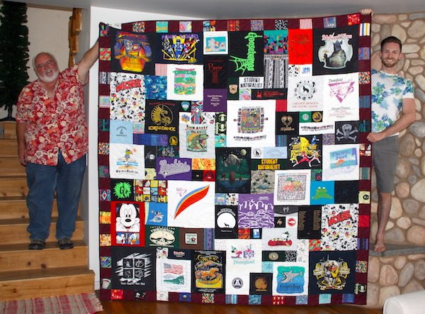 A father and son enjoy a new T-shirt quilt