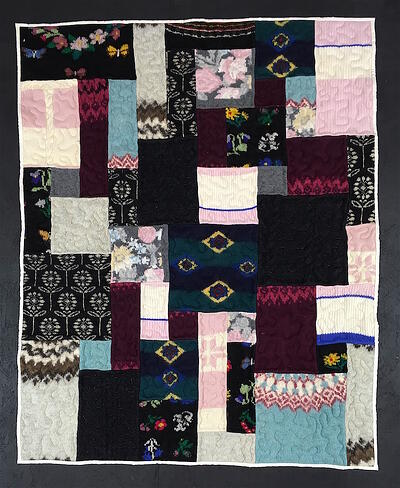 Wool Sweaters made into a quilt.
