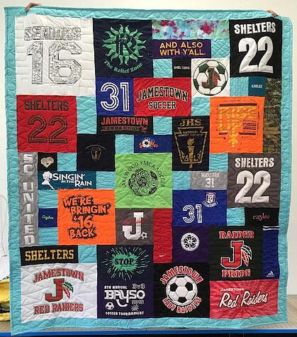 T-shirt quilt with a teal border