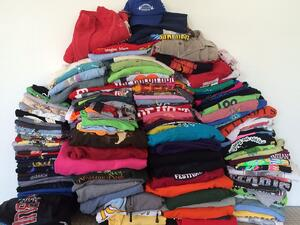 This is a pile of way too many sorority T-shirt waiting to be made into a quilt