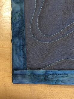 back of binding on a T-shirt quilt - looks great