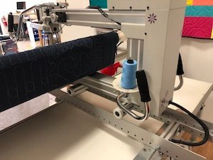 This is how much of the front of a quilt you see when you work from the back of a long-arm machine. You don't see the quilt at all!