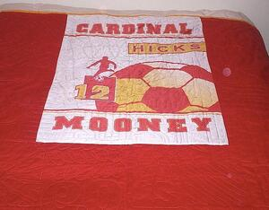 banner on the back of a quilt mooney