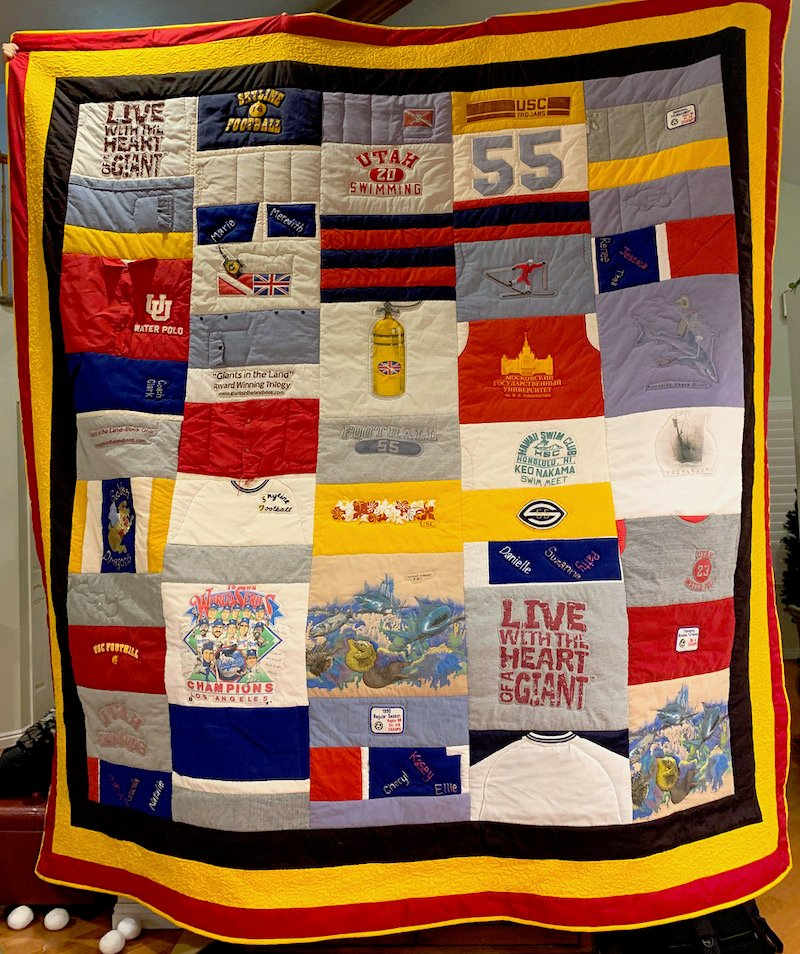 T-shirt quilt with unequal rows.