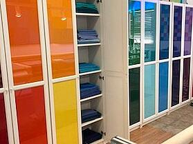 binding fabrics for t-shirts arranged on shelves