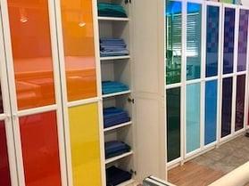 binding fabrics for t-shirts arranged on shelves