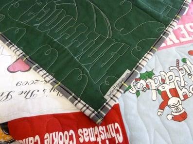 binding made from a school uniform skirt on a T-shirt quilt