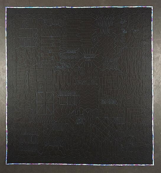 black back of a T-shirt quilt - awesome quilting